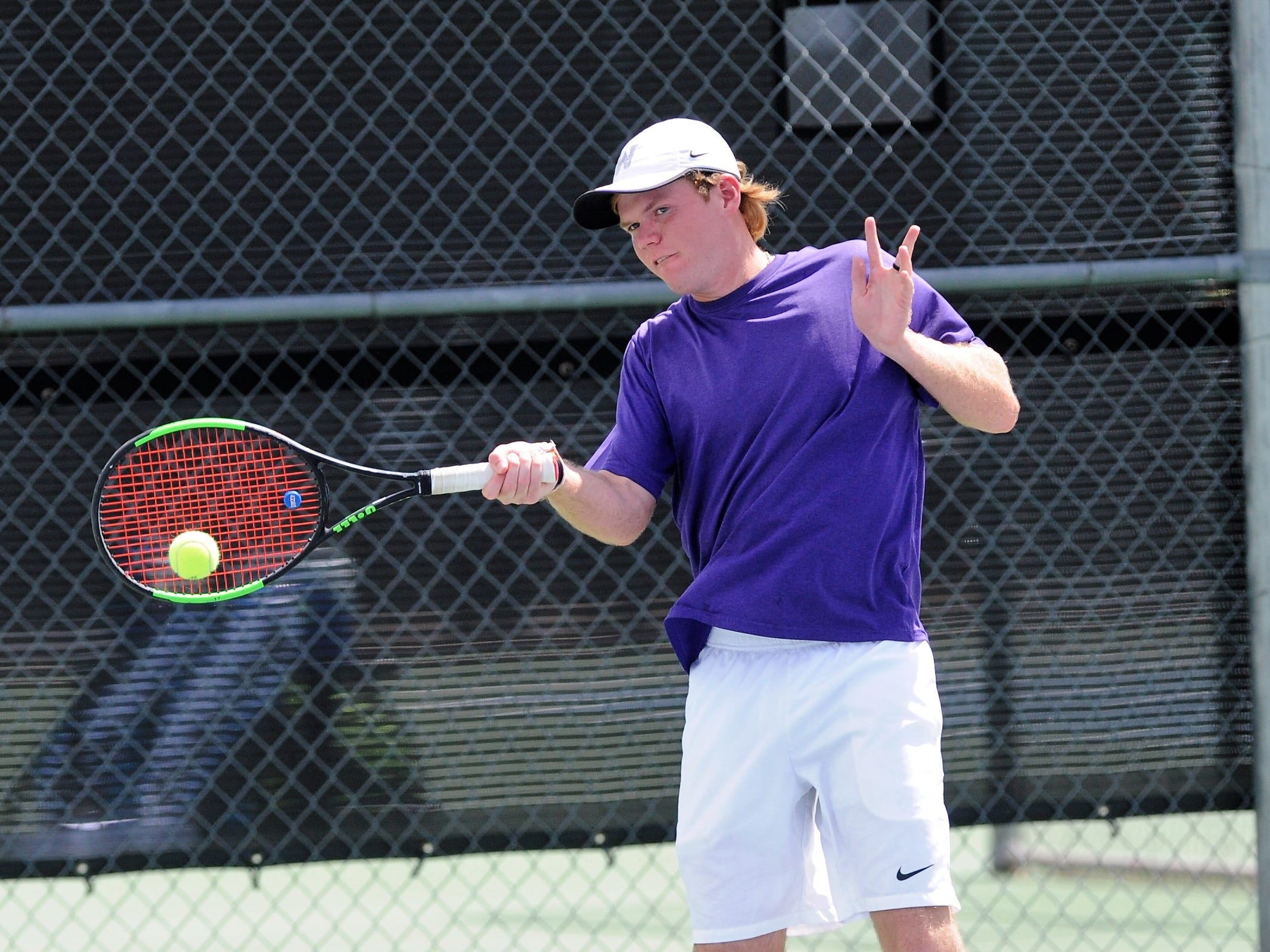 Wylie's Cole Edwards hits a shot during Tuesday's contest against Midlothian. Edwards and partner Aric Richardson won 6-0, 6-3 at No. 2 boys doubles.