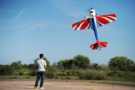 Joy Lewis/Reporter-News Dominic Grassor performs a torque roll with his Sukhoi Su-35 Friday, October 17, 2014 at Seabee Park.