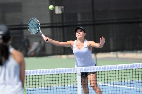 Wylie's Analeah Elias reaches for a shot during Tuesday's match against Midlothian. Elias and partner Leighton Alford won 6-0, 6-0 at No. 1 girls doubles.
