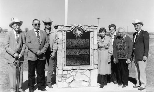 Dignitaries who worked on a historical marker in 1990 were, from left, A.R. Sawyers, County Judge Ed Wolsch, George Weiser, Bess Weiser, Hazel Letz, Bernice White and P.C. Carr.