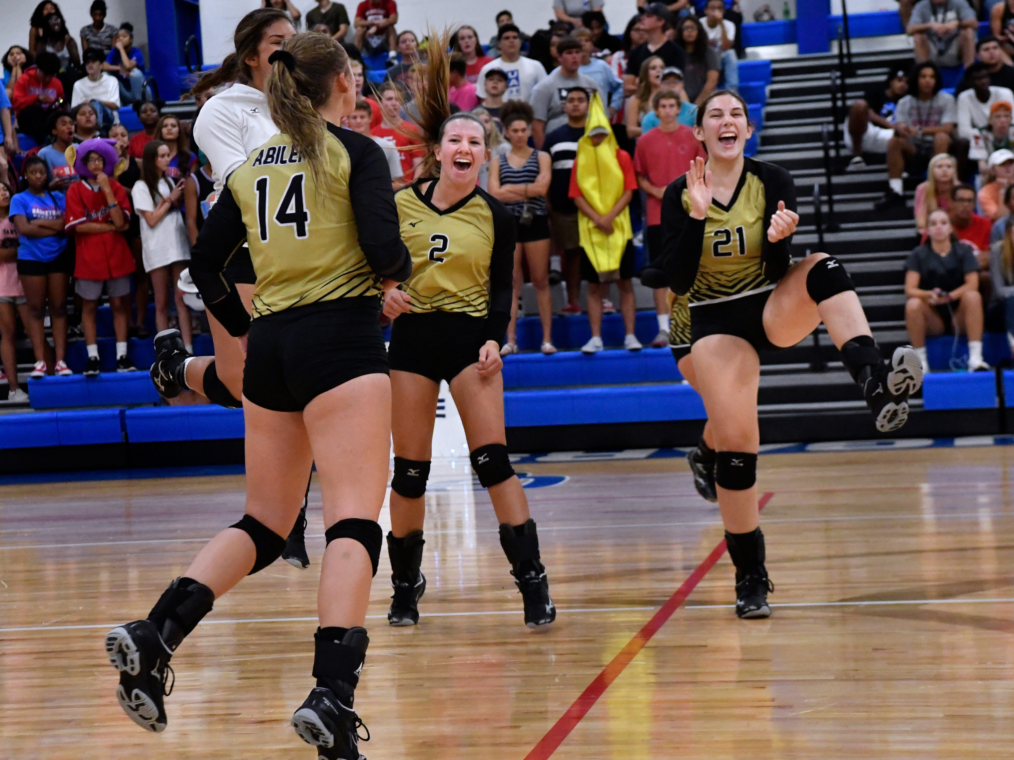 The Abilene High School Lady Eagles celebrate their win over Cooper High School Tuesday August 7, 2018. Final score in the crosstown volleyball best-of-five match was 25-21, 16-25, 25-20, 17-25, 15-7.