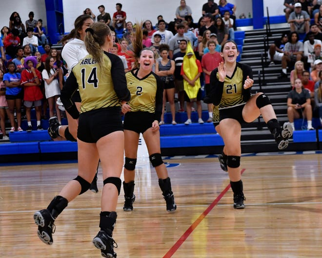 Abilene High players celebrate their win over Cooper in last season's match Aug. 7 at Cougar Gym. The Lady Eagles won the match 25-21, 16-25, 25-20, 17-25, 15-7. The two teams open the season against other at 6 p.m. Tuesday at AHS' Eagle Gym.