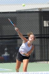 Wylie's Leighton Alford serves during Tuesday's match against Midlothian. Alford and Analeah Elias won 6-0, 6-0 at No. 1 girls doubles.