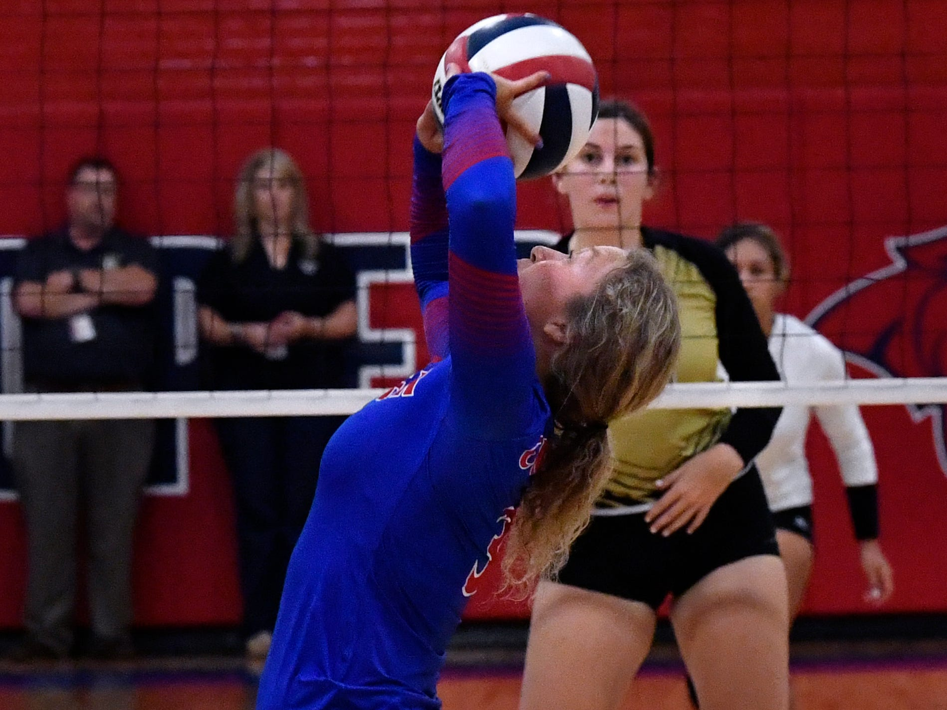 Cooper's Pearce Bjorlie sets the ball as Abilene High's Sydney Lawler waits for the spike. Abilene High won the crosstown volleyball game Tuesday August 7, 2018 against Cooper High in the best-of-five match, 25-21, 16-25, 25-20, 17-25, 15-7.