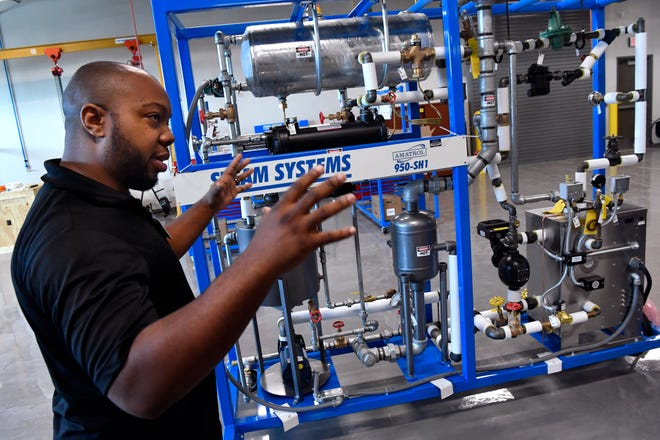 Demitri Jones on Wednesday shows an industrial boiler simulator in the Industrial Maintenance Technology lab at the new Texas State Technical College campus in Abilene. Enrollment has begun for the new $12 million campus.