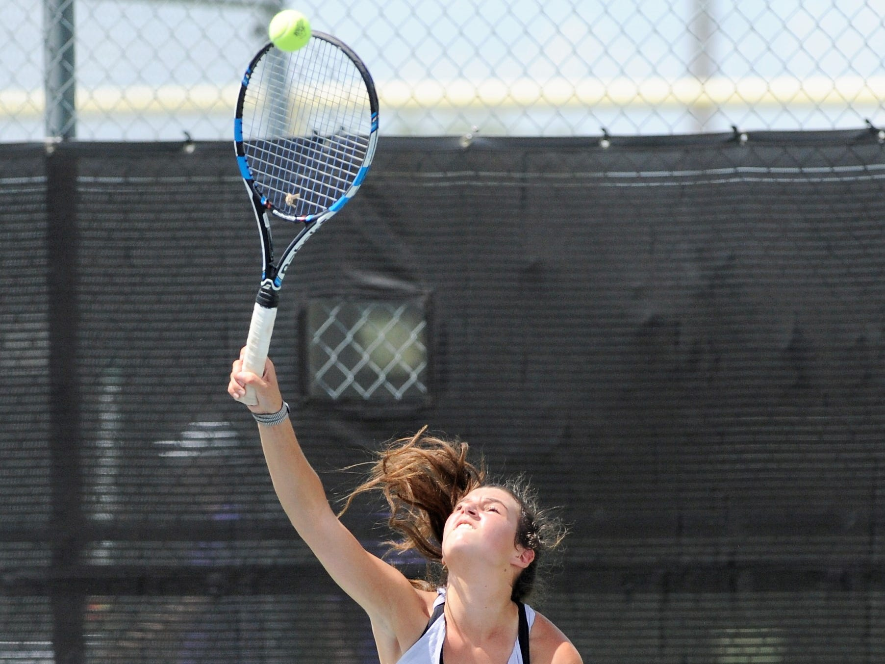 Wylie's Madison Andrews serves during Tuesday's match against Midlothian. Andrews and partner Elle Schroeder won 6-0, 6-0 at No. 2 girls doubles.