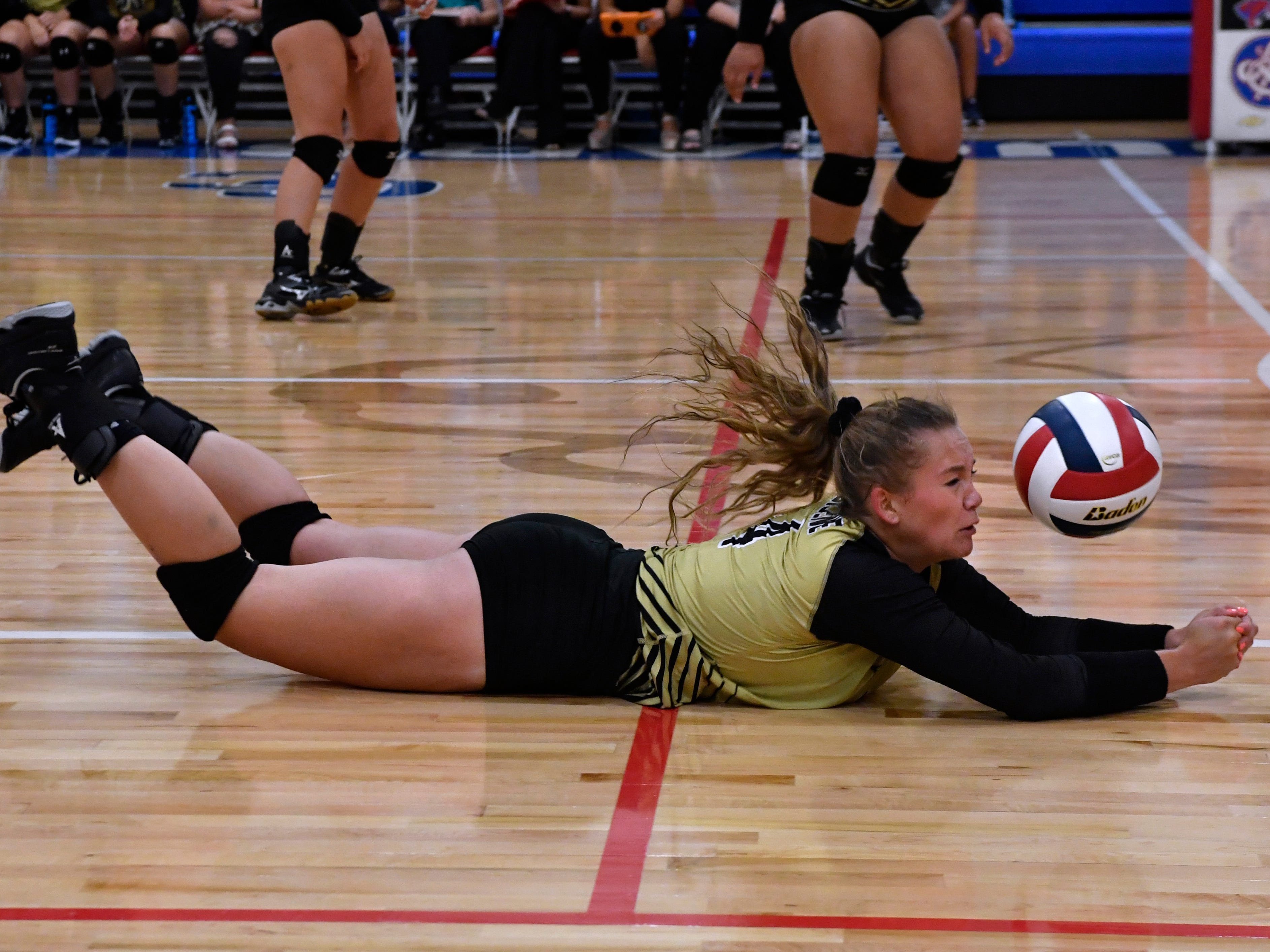 Abilene High's Emilee Rhodes dives for the ball at Cougar Gym. Abilene High won the crosstown volleyball game Tuesday August 7, 2018 against Cooper High in the best-of-five match, 25-21, 16-25, 25-20, 17-25, 15-7.