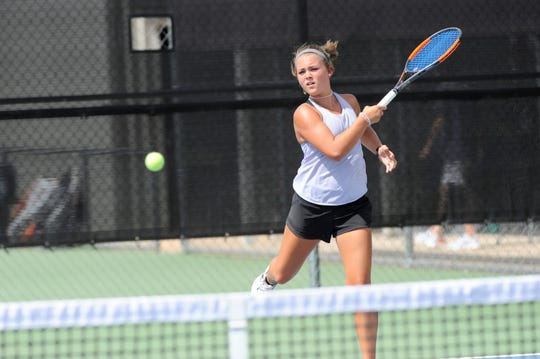 Wylie's Leighton Alford follows through on a shot during Tuesday's match against Midlothian. Alford and Analeah Elias won 6-0, 6-0 at No. 1 girls doubles.