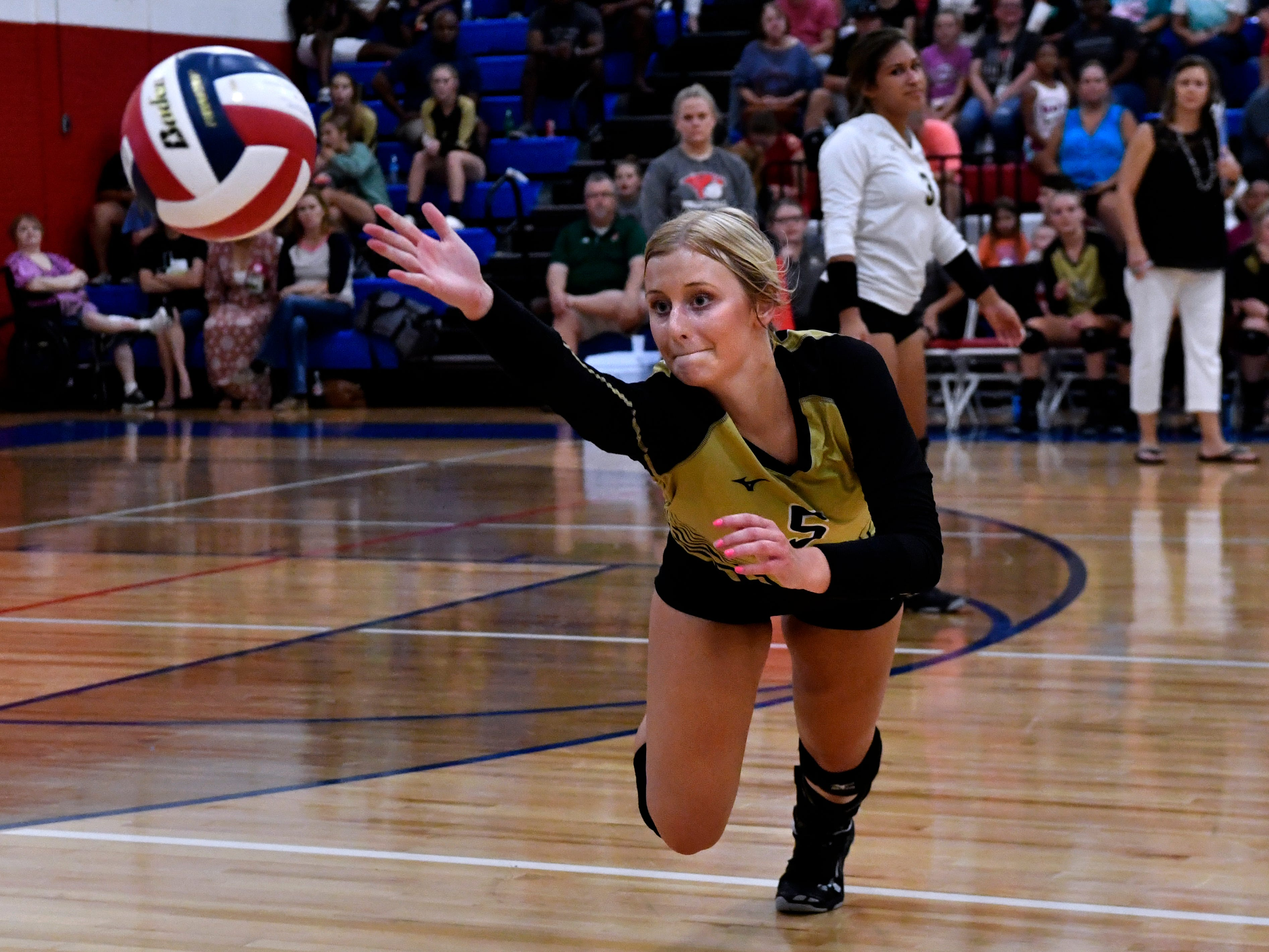 Abilene High's Allison Pierce dives for the ball as it flies out-of-bounds during the Lady Eagles crosstown game against Cooper High School Tuesday August 7, 2018 at Cooper. Abilene beat the Lady Coogs in the best-of-five match, 25-21, 16-25, 25-20, 17-25, 15-7.