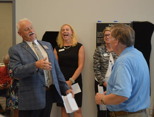 As KCC celebrated the opening of the new Miller Physical Education Building, KCC President Mark O'Connell, left, tells a story about Al Bobrofsky, right, being the referee for the first basketball game ever played at the old KCC gym in 1966.
