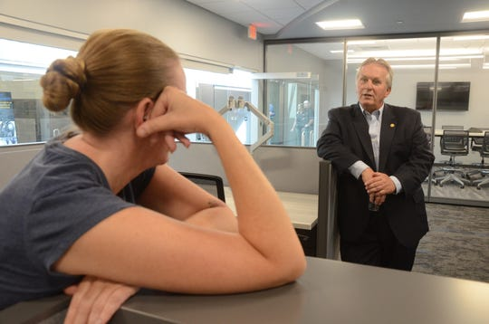 Detective Stephanie Estree talks with State Sen. Mike Nofs during tours of the building.