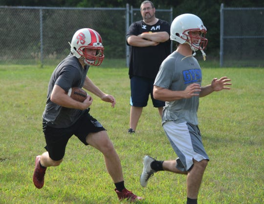 St. Philip players work on offensive drills during preseason practice earlier this week as the Tigers get ready for the 8-man football season.