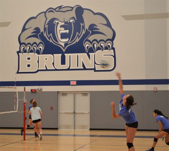 The Kellogg Community College volleyball team goes through an informal practice as community members watch during the open house for the new Miller Physical Education Building.
