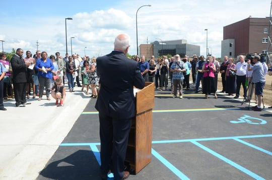 Mayor Mark Behnke speaks to guests before a tour of the new police station.