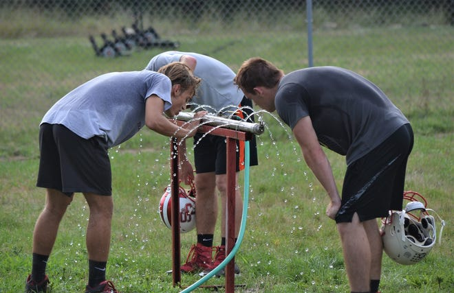 St. Philip players take a water break during preseason practice earlier this week as the Tigers get ready for the 8-man football season.