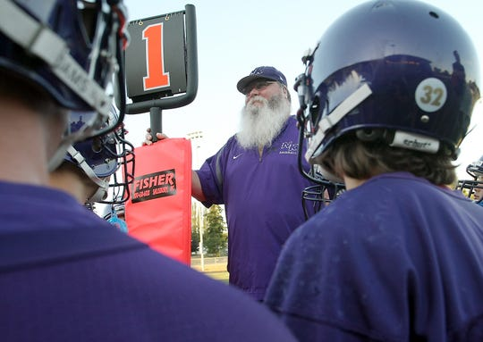 Among his volunteer endeavors, Bryan Johansen helped with down markers at North Kitsap High School.