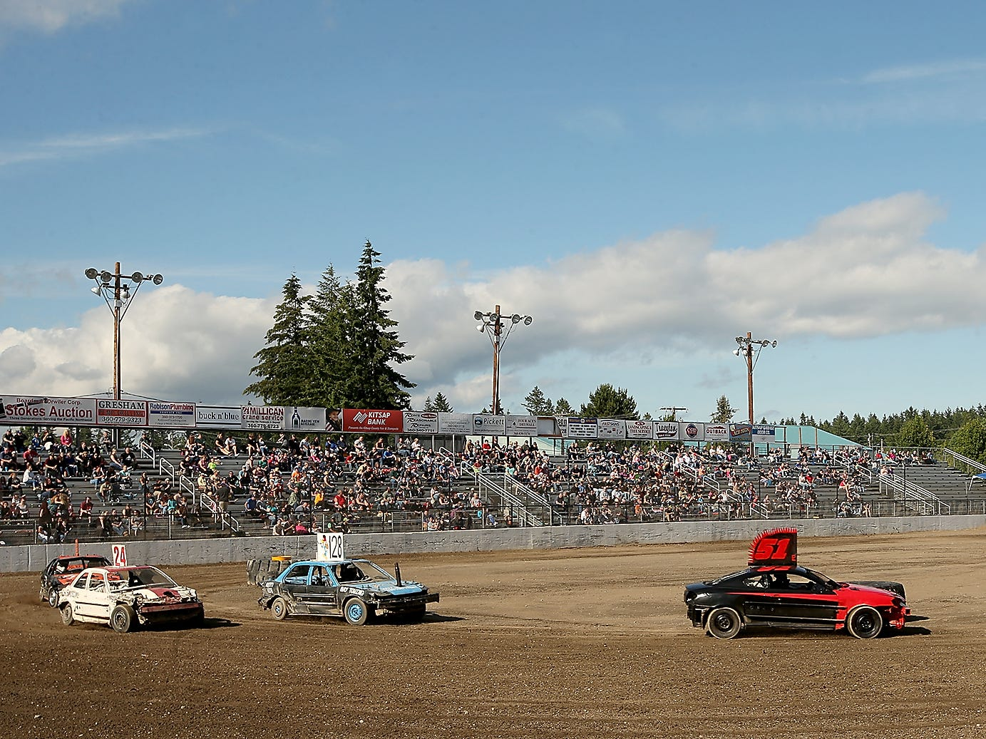 Mini entries speed around the track for the Kitsap Destruction Derby at Thunderbird Stadium on Saturday, June 23, 2018.