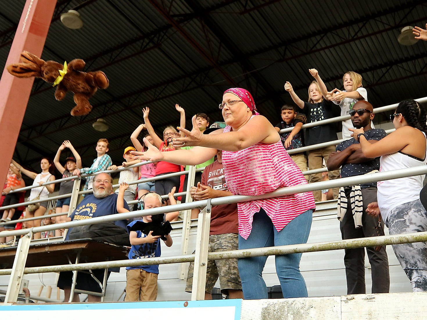A stuffed rabbit is launched into the crowd during intermission of the Kitsap Destruction Derby at Thunderbird Arena at the Kitsap County Fairgrounds on Saturday, July 28, 2018.