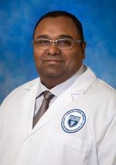 Dr. David Bhola