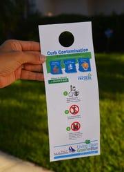 A Melbourne recycling cart doorknob hanger.