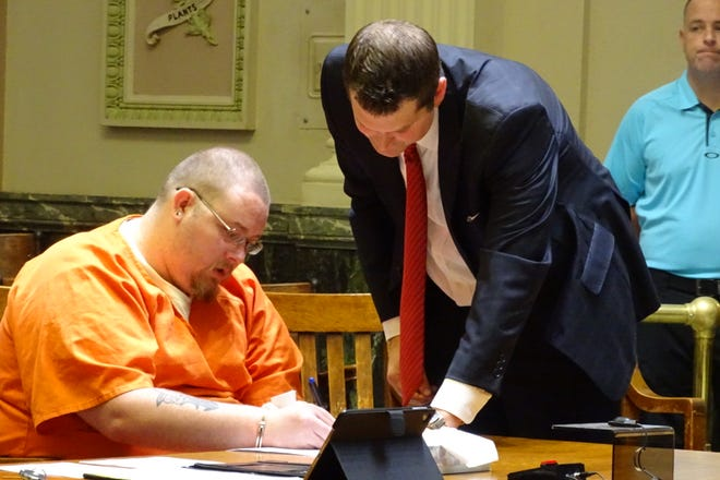 Martin Nolen signs away his right to a jury trial Wednesday before pleading guilty to rape.