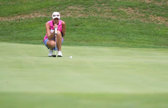 Tiffany Maurycy reads her birdie putt on the 17th hole during the final round of the Vermont women's amateur golf championship on Wednesday at Country Club of Vermont in Waterbury.