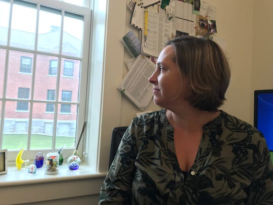 Karen Shea deputy commissioner of the Department of Children and Families explained inter-agency communications at her desk in Waterbury on Aug. 2, 2018.