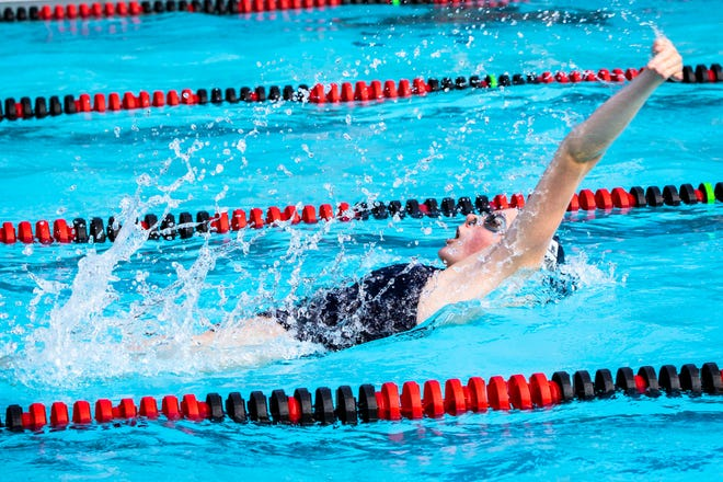 Ella Miller (17, EDGE) breaks out of the water during her first place 100 Yard backstroke at the Champlain Valley Swim League Championships on Friday at Sand Hill Pool in Essex.
