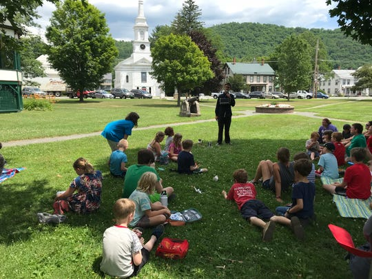 Children gathered in mid-summer on Royalton's town center green to catch free summer performances.