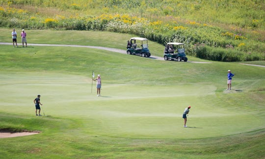 Players contend with the seventh green during the final round of the 2018 Vermont women's amateur golf championship at Country Club of Vermont in Waterbury.