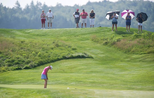 Spectators watch as Tiffany Maurycy putts on the fourth hole during the final round of the Vermont women's amateur golf championship on Wednesday at Country Club of Vermont in Waterbury.