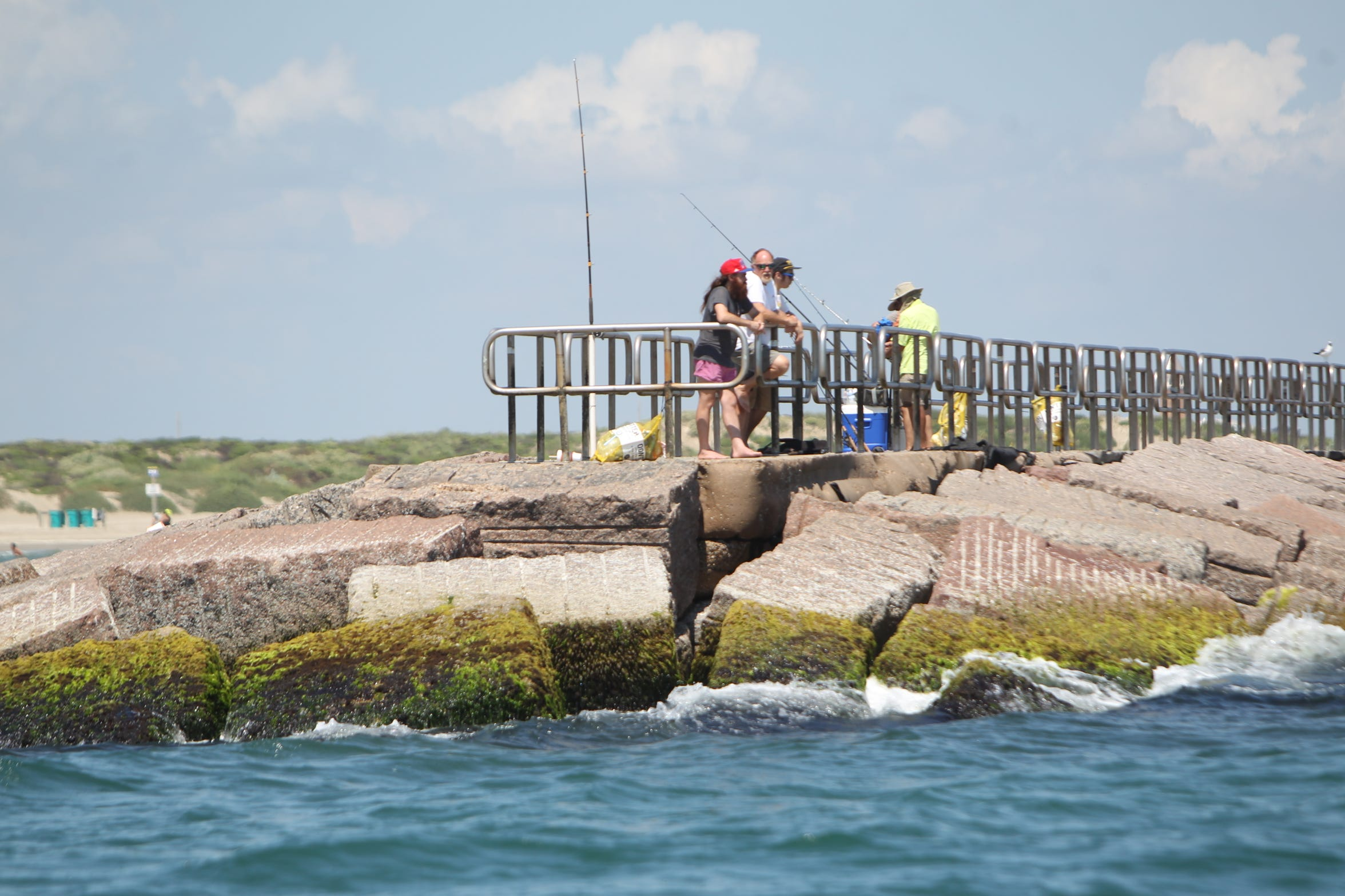 When the waves settle around the Packery Channel jetty, tarpon anglers begin searching for surfacing tarpon.
