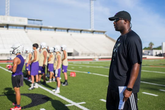 Miller head coach Justen Evans watches as his practices before the start of the season on Tuesday, August 7, 2018 at Buccaneer Stadium.