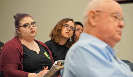 Members of the Corpus Christi Immigration Coalition listen to a presentation on Nueces County's involvement in the federal 287(g) program during an Aug. 8, 2018 meeting of the county commissioners court.