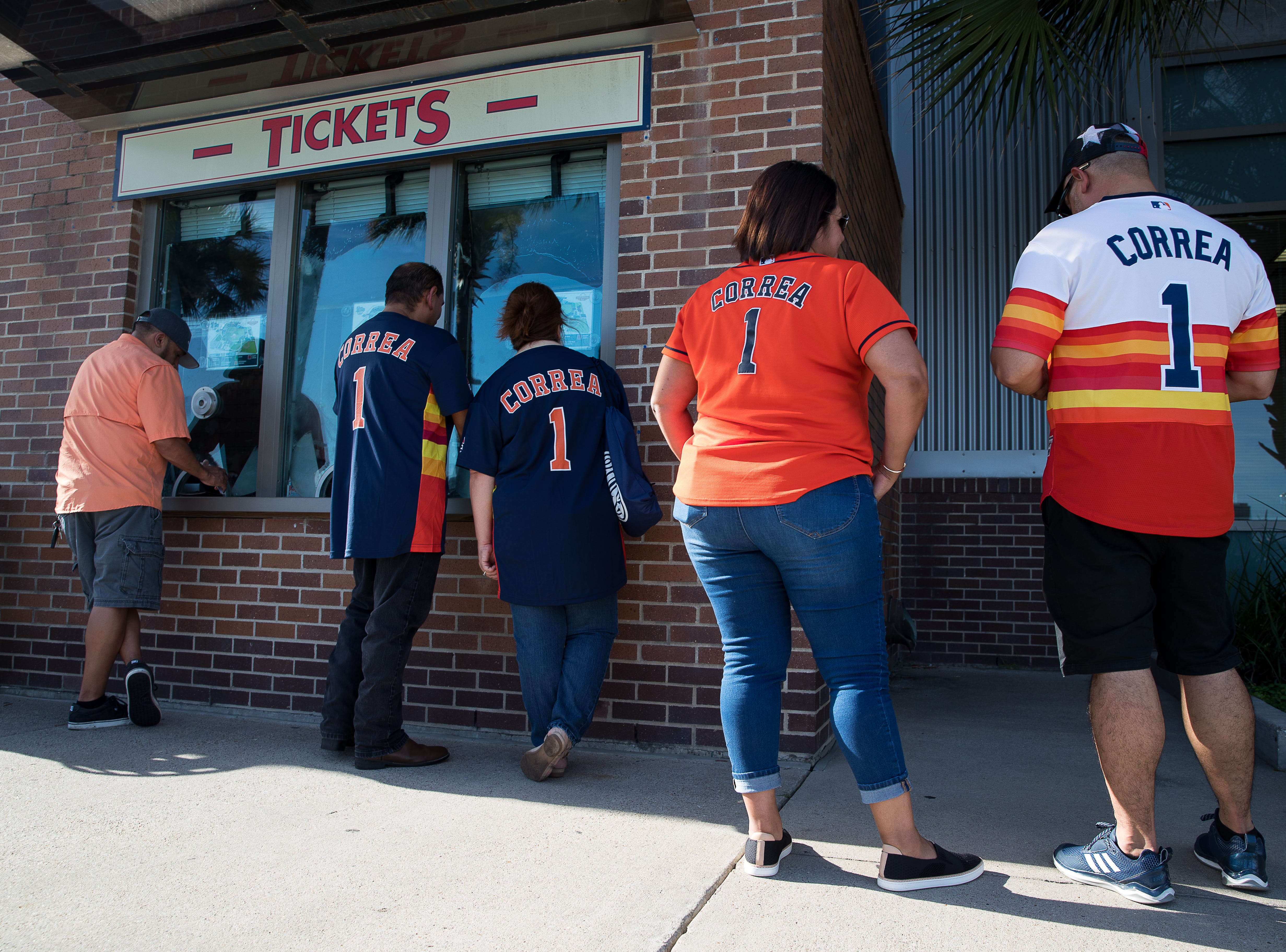 Fans in Carlos Correa Astros jerseys buy tickets outside Whataburger Field before a Hooks game where Correa is playing on a rehab assignment Tuesday, Aug. 7, 2018.