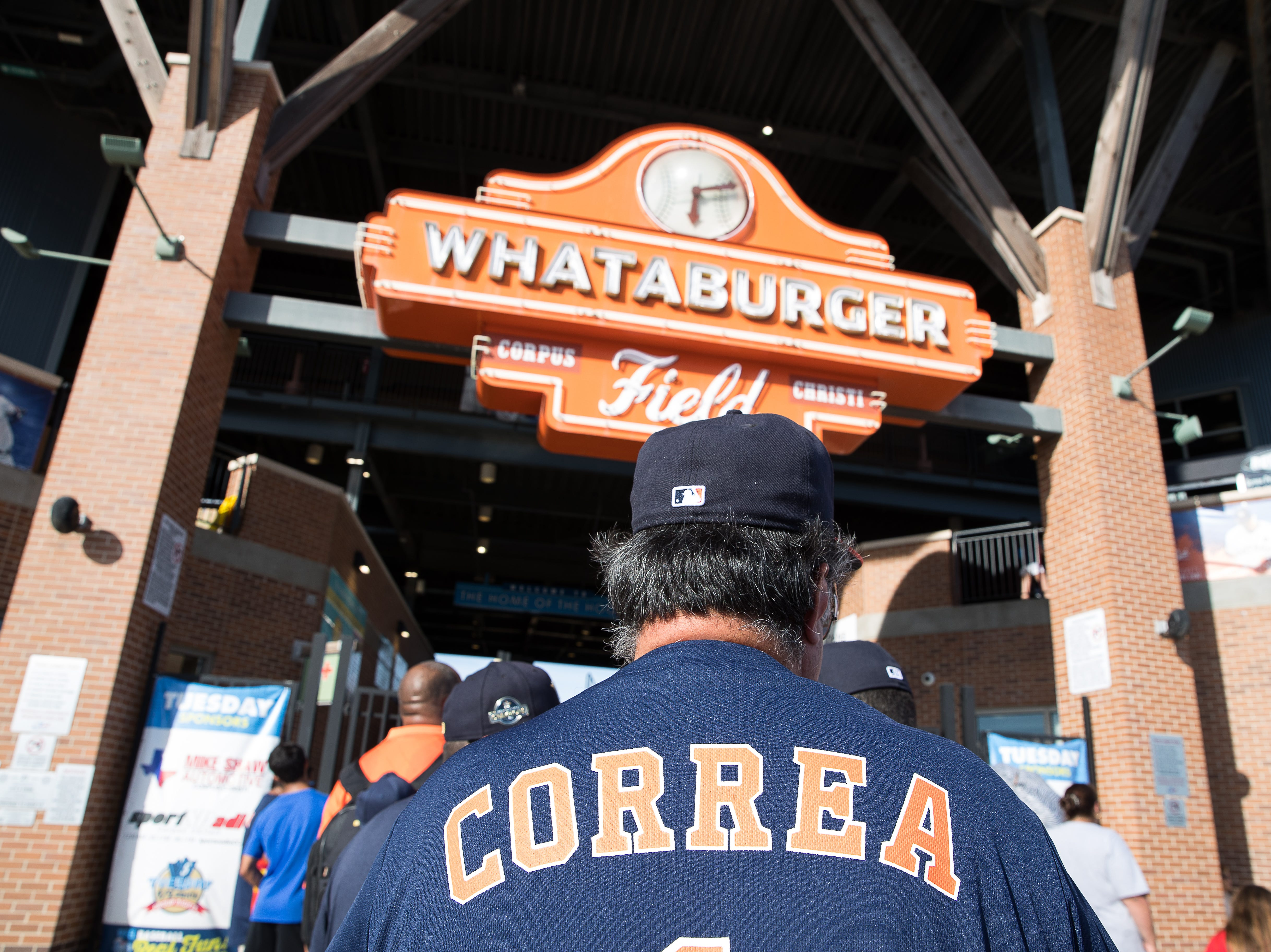 A fan wears a Carlos Correa Houston Astros jersey outside Whataburger Field before a Hooks game where Correa is playing on a rehab assignment Tuesday, Aug. 7, 2018.