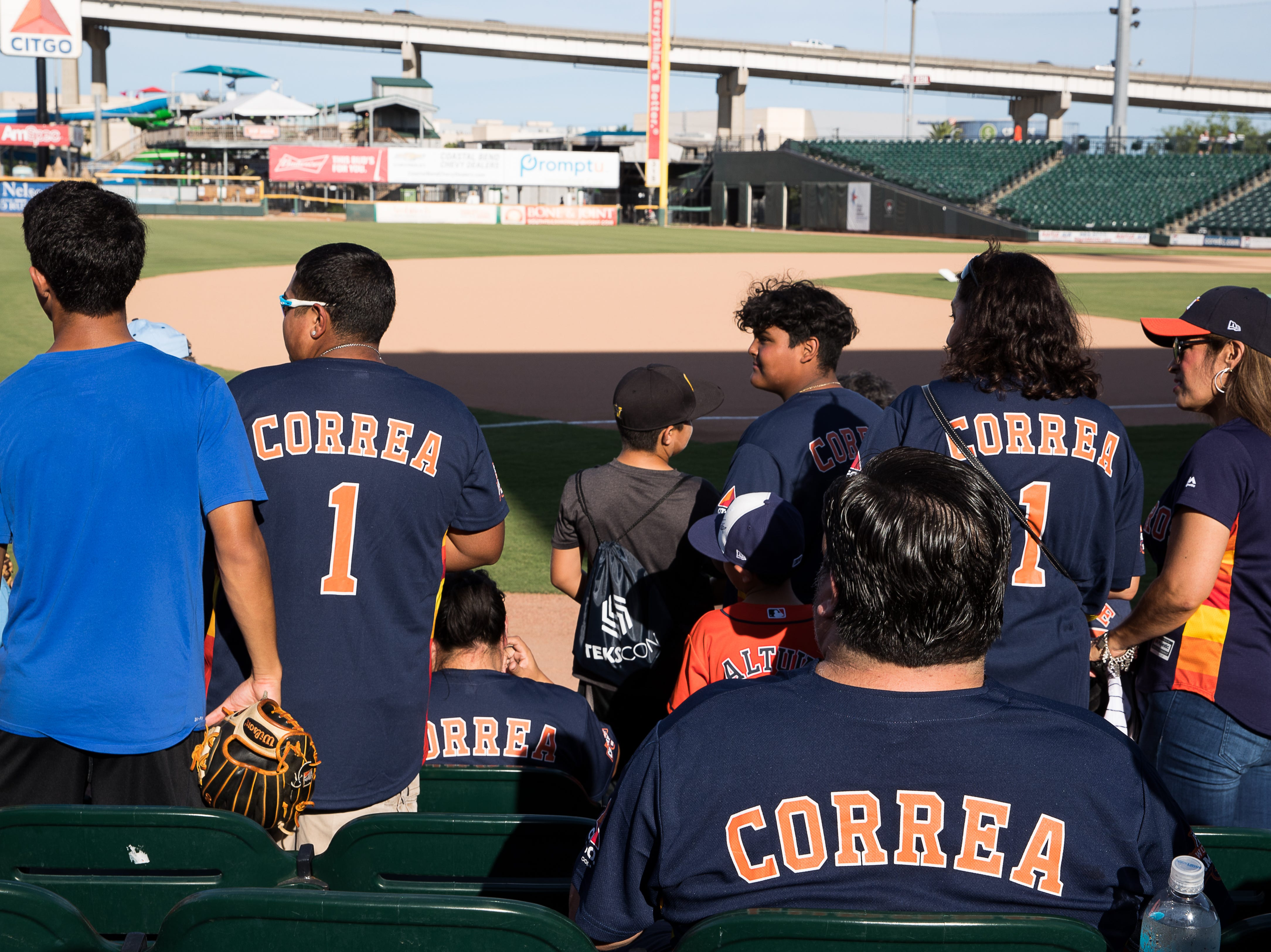 Fans in Carlos Correa Astros jerseys sit in the stands at Whataburger Field before the Hooks game where Correa is playing on a rehab assignment Tuesday, Aug. 7, 2018.