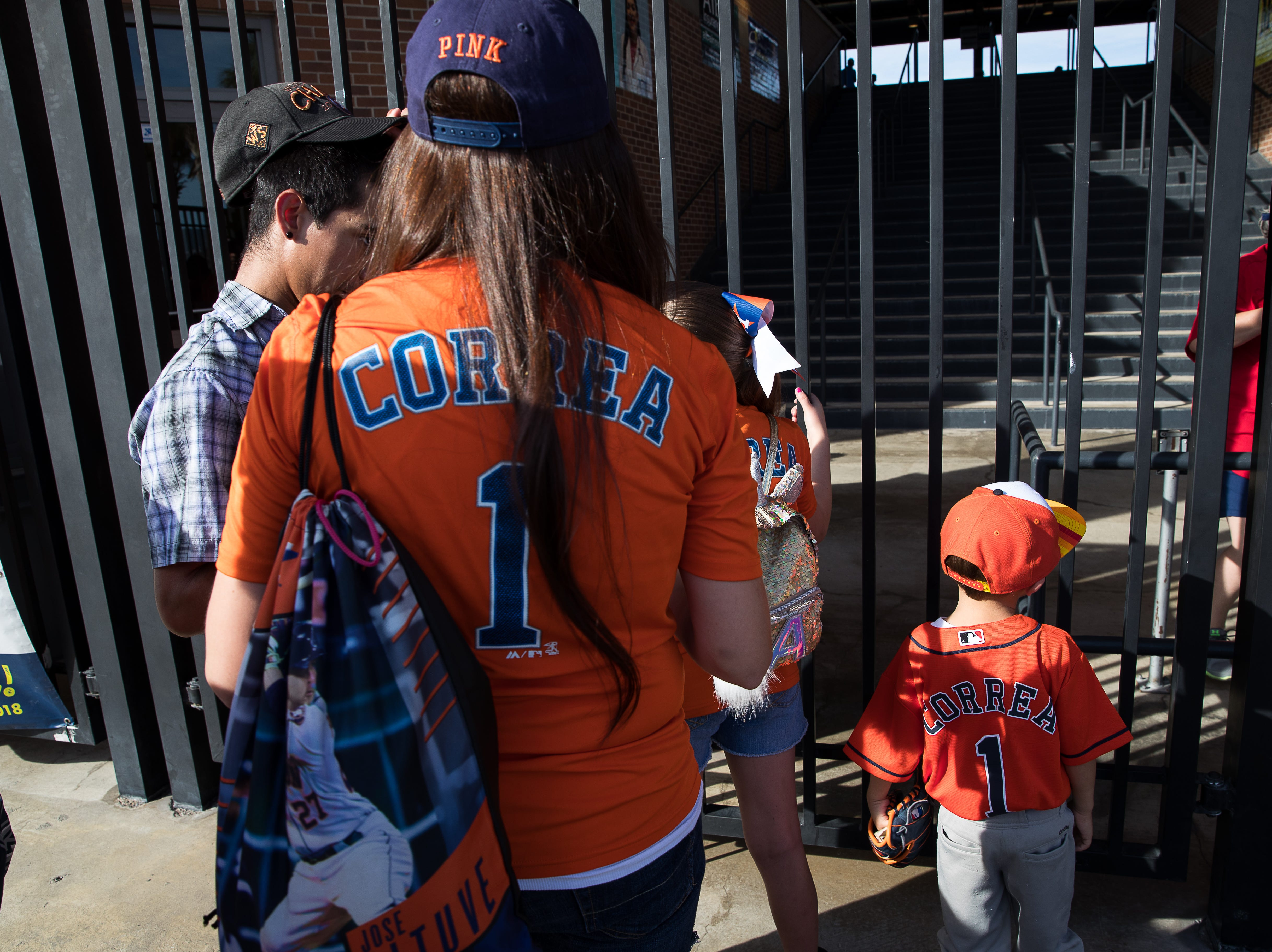 Fans in Carlos Correa Houston Astros jerseys wait outside Whataburger Field before a Hooks game where Correa is playing on a rehab assignment Tuesday, Aug. 7, 2018.
