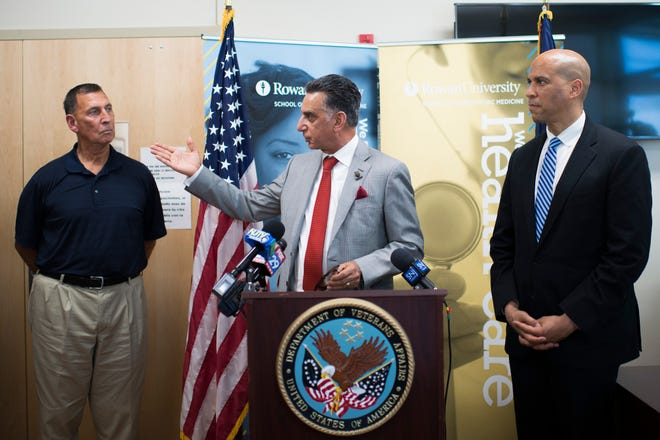 Rowan University President Ali Houshmand, center, speaks alongside Congressman Frank LoBiondo, left, and Sen. Cory Booker at a Veterans Affairs outpatient clinic in Vineland, N.J., Wednesday. The officials announced a new partnership between the Wilmington Veterans Affairs Medical Center and Rowan University School of Osteopathic Medicine that will give residents an opportunity to train in South Jersey clinics.