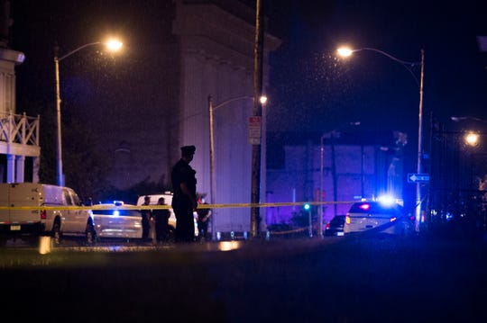 Police respond after two Camden County undercover detectives were shot Aug. 7 near Broadway and Walnut Street in Camden.