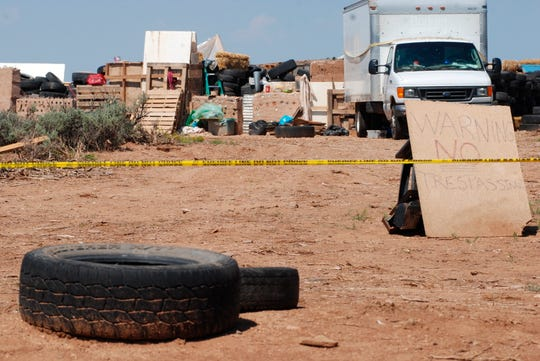 Police tape restricts access to a disheveled living compound in Amalia, N.M., on Tuesday, Aug. 7, 2018. A New Mexico sheriff said searchers have found the remains of a boy at the makeshift compound that was raided in search of a missing Georgia child. A New Mexico sheriff said searchers have found the remains of a boy at the makeshift compound that was raided in search of a missing Georgia child.