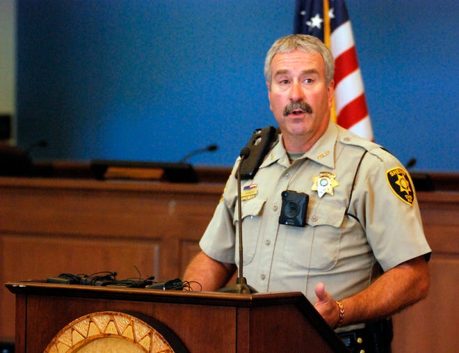 Taos County Sheriff Jerry Hogrefe announces at a news conference in Taos, N.M., on Tuesday, Aug. 7, 2018, that searchers have found the remains of a boy at the makeshift compound that was raided in search of a missing Georgia child. Hogrefe said authorities are awaiting a positive identification of the remains found Monday on the outskirts of Amalia, N.M. Authorities say the search for the child led them Friday to the squalid compound where they found his father, four other adults and 11 children living in filthy conditions.