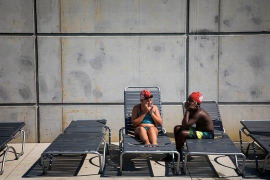 Myla McKinney and Ben Yisrael take a break during a Rhinos practice.
