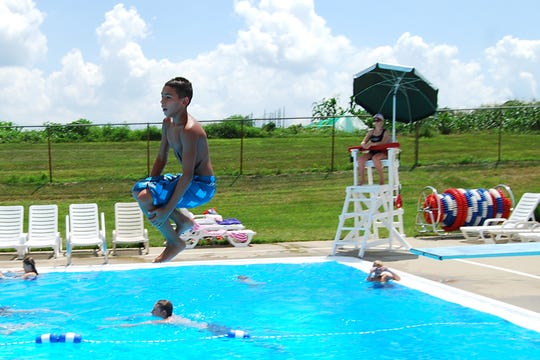 Several summers ago Tyler Sizemore, of Union, does a cannon ball off of the Union Pool diving board.