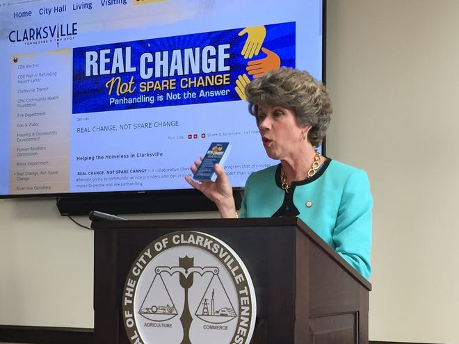 Clarksville Mayor Kim McMillan holds up cards that law enforcement officers can give to panhandlers directing them to agencies that need help as part of a 'Real Change, Not Spare Change' program launched Tuesday.
