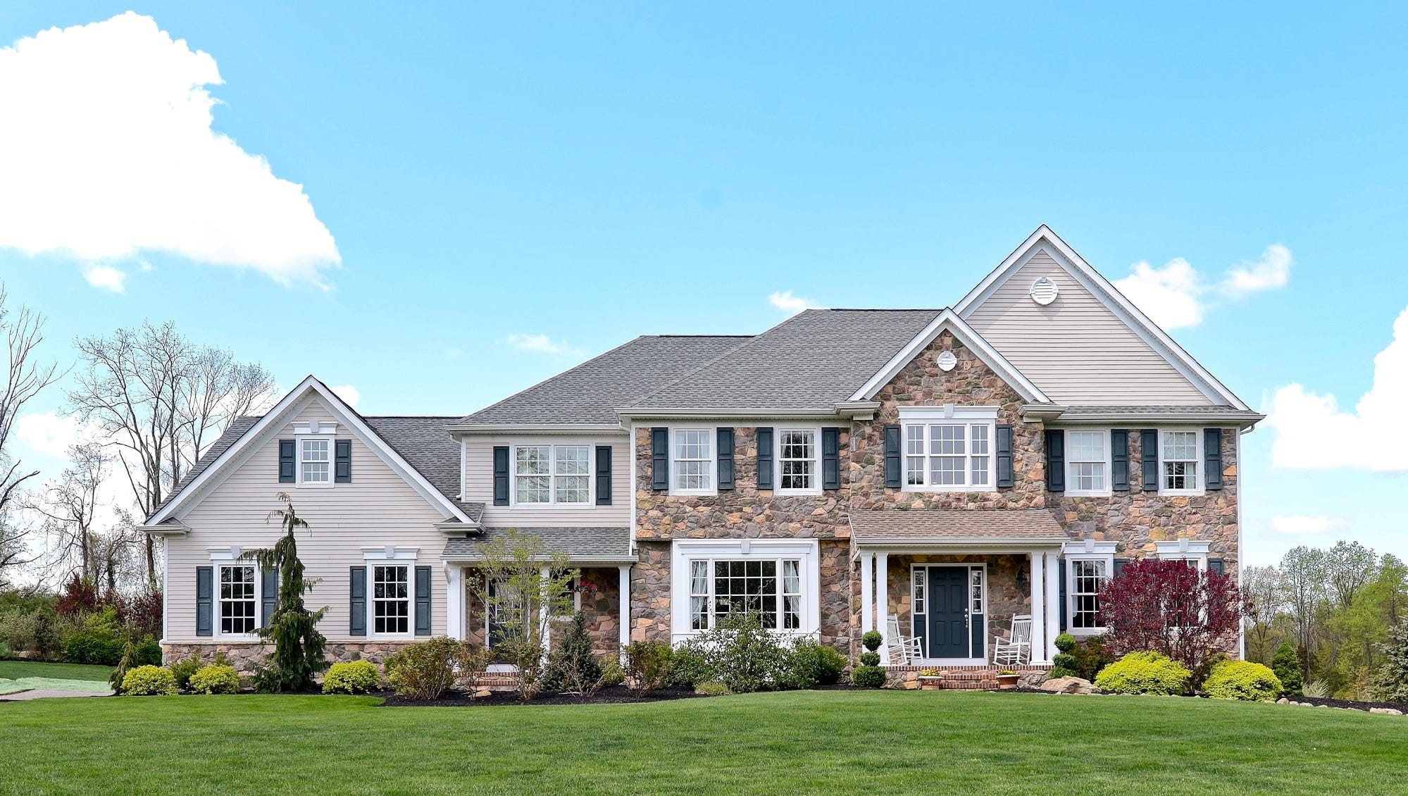 This four-bedroom Colonial in Still Hollow Estates, Tewksbury, has a gourmet kitchen open to the two-story family room.  It's offered at $899,900.