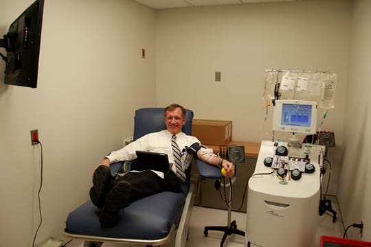 Robert Coates, M.D., Chief Medical Officer at Hunterdon Medical Center, pictured after donating blood at Hunterdon Medical Center's Blood Bank.