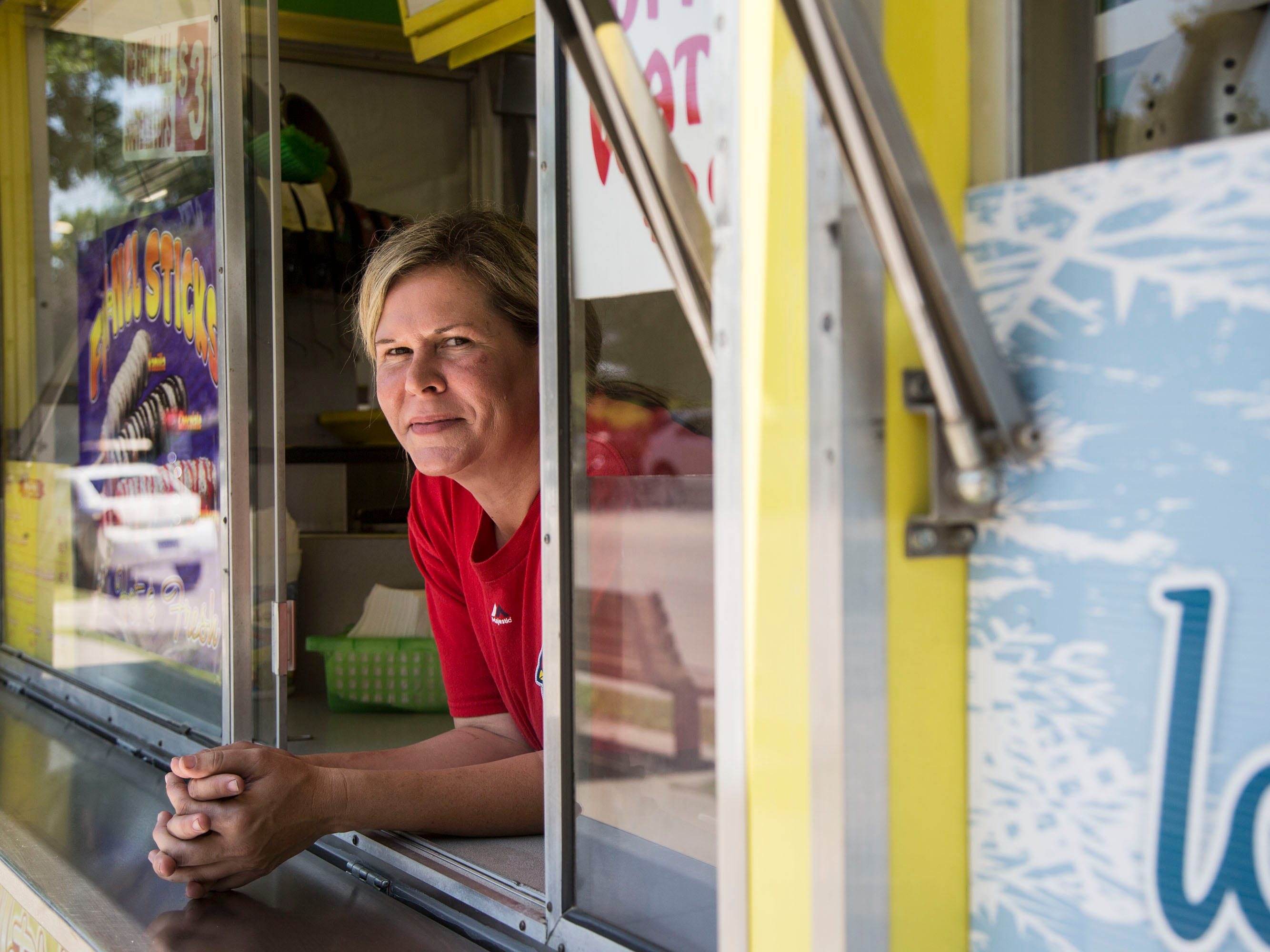 Carrying on her family's tradition, Jada Smith, owner of Jada Concessions, is back at the Iowa State Fair as a concessionaire, selling funnel cakes, for the first time since her parents, one of the first to bring funnel cake to the fair, were murdered there in 1996. She stands inside her trailer on Wednesday, Aug. 8, 2018, the day before the fair begins.