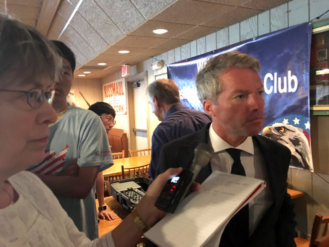 Eric Branstad, who directed President Trump's 2016 election campaign in Iowa, speaks to reporters on Aug. 8, 2018 after the Westside Conservative Club meeting at the Machine Shed restaurant in Urbandale, Iowa.