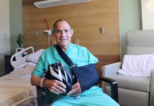 Dr. Richard Deming sits in Mercy's new rehab hospital recuperating from a traumatic bike accident.